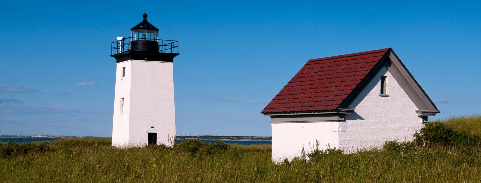 Race point light and coast guard station in the dune of Cape Cod