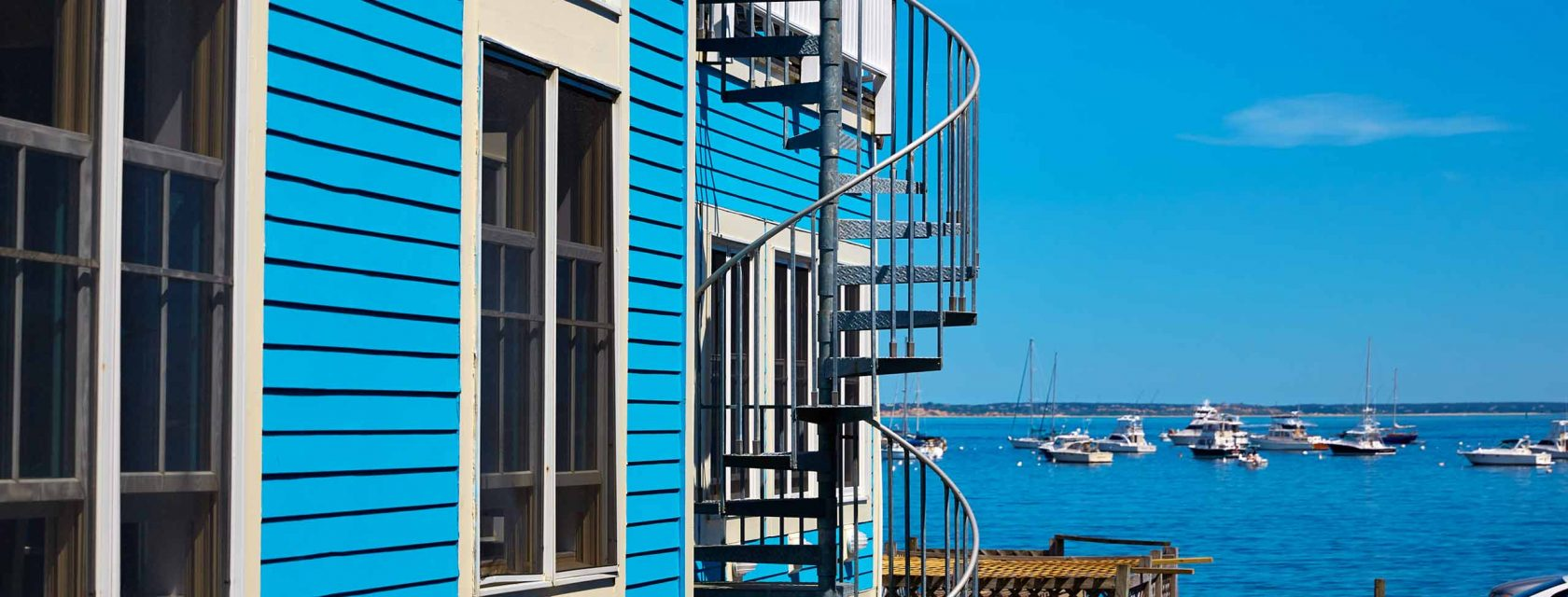 A spiral staircase from an upstairs condo overlooking Cape Cod Bay in Ptown